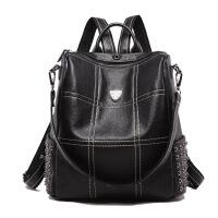 2018欧美新款女包牛皮时尚铆钉真皮双肩包大容量旅行包 黑色