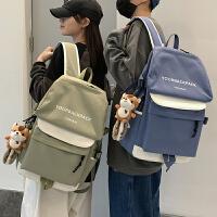 撞色大容量书包男韩版潮高中大学生双肩包女轻便运动情侣旅行背包
