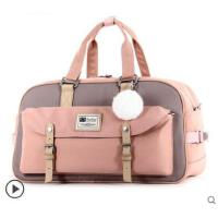 大方便携旅行袋行李包防水旅游包手提女男多功能大容量韩版甜甜圈包